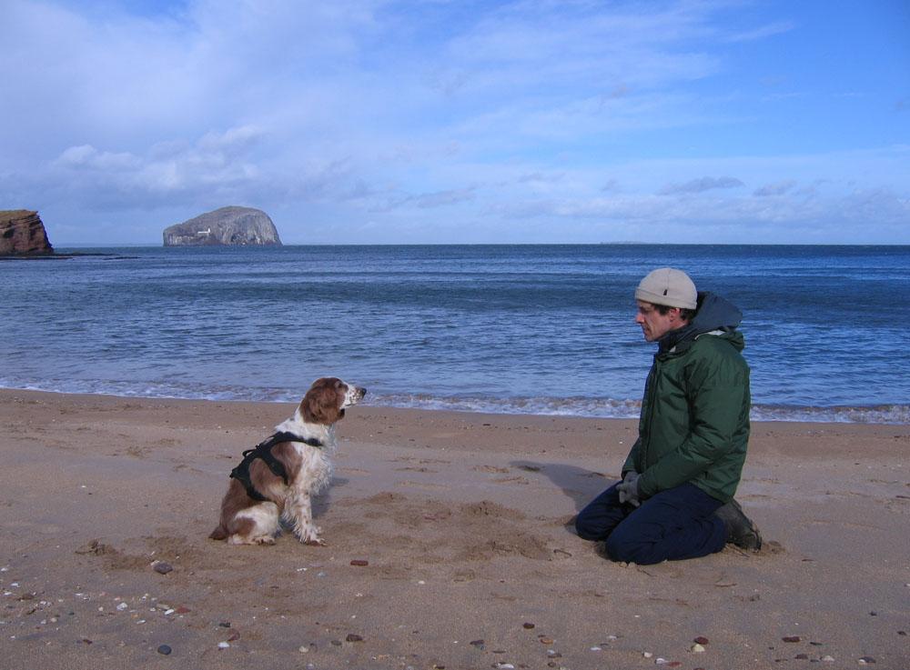 man and dog on Seacliff beach