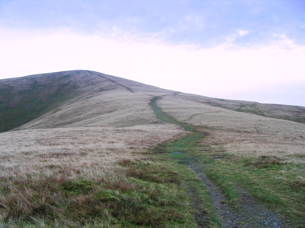 photo of path leading to hill summit