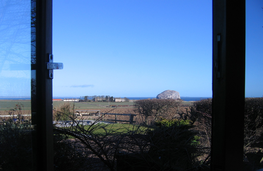 view of Bass Rock through window