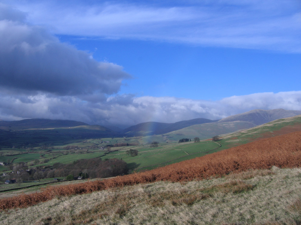 image of rainbow over hills
