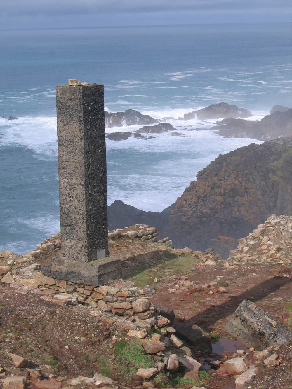 a brick column on the edge of a Cornish cliff