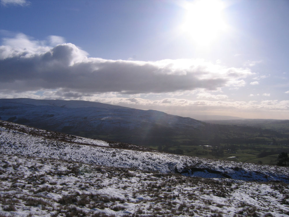 image showing sun, cloud and snowy hills