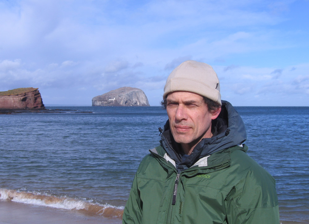 man with sea and Bass Rock