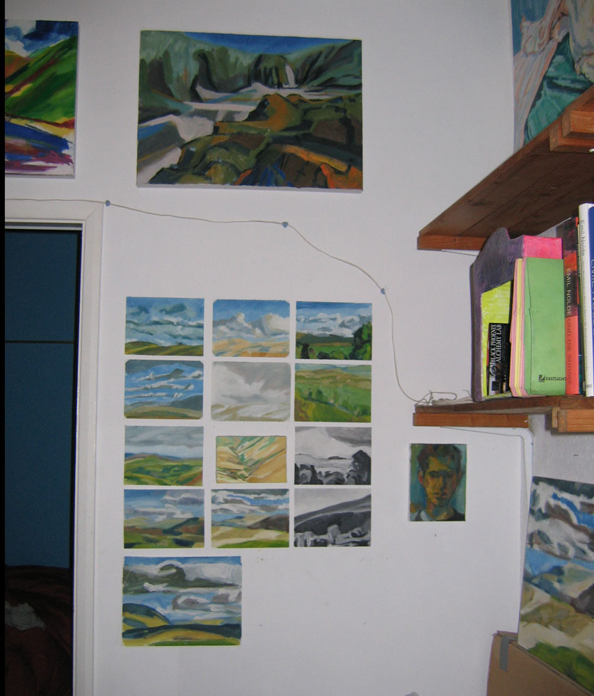 photo of studio wall with paintings