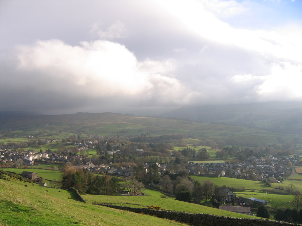photo of bad weather approaching across the hills