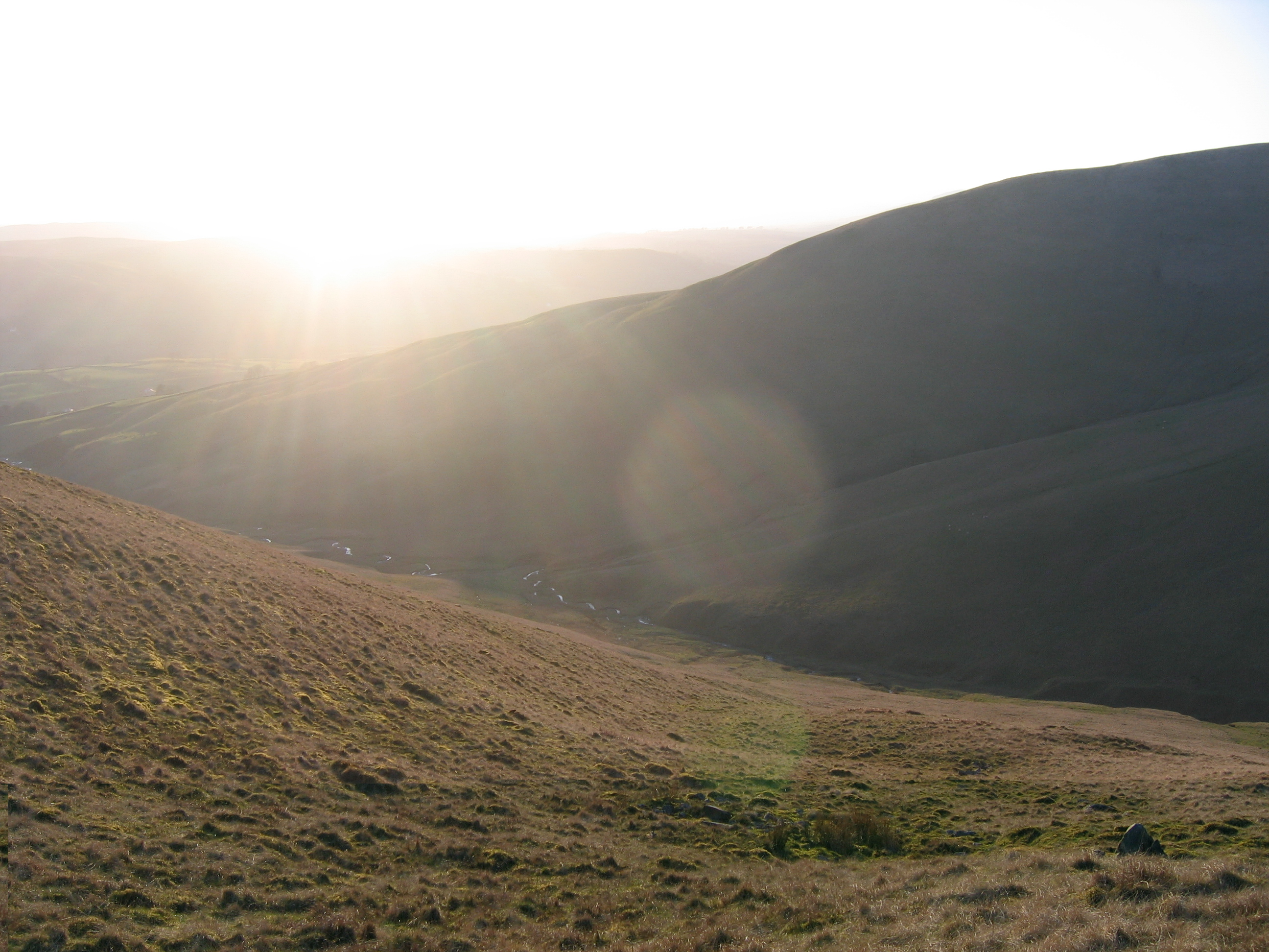 hills in evening light, bright sun