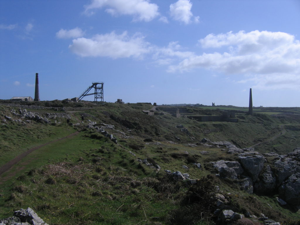 mining remains, chimneys and St Just church in the distance, Cornwall photo