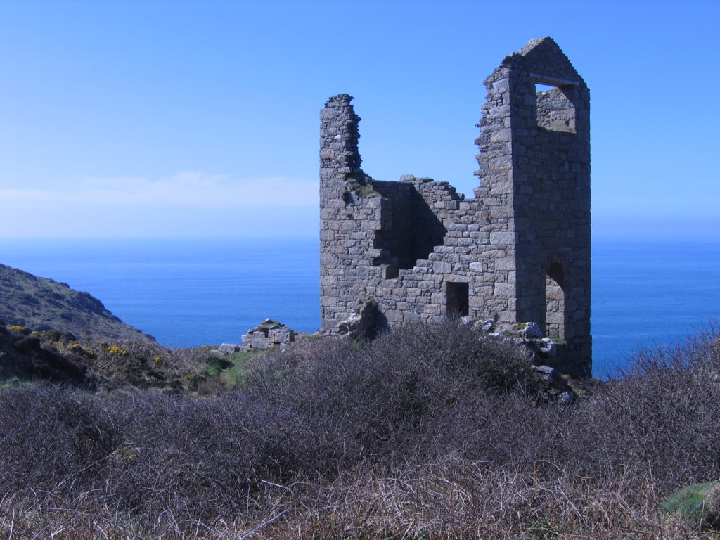 photograph showing a ruined mine building on a Cornish cliff