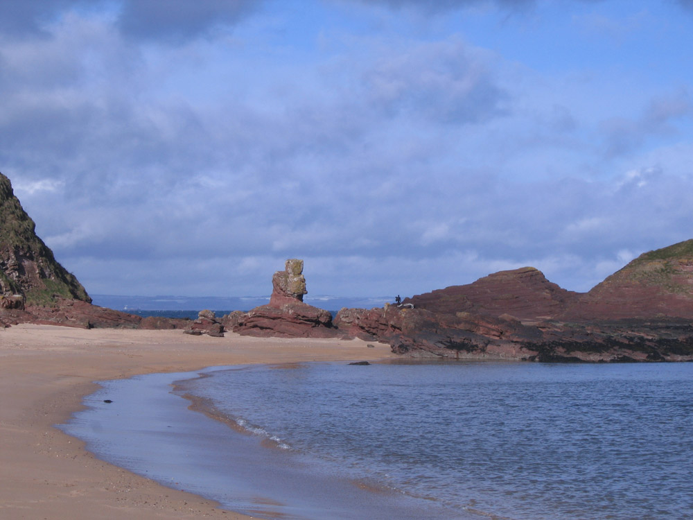 image showing strange rocks and forms resembling figures on a beach