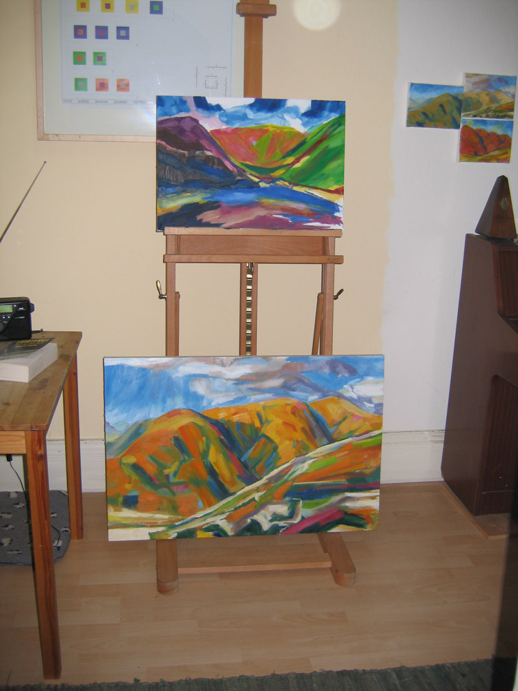 easel with two oil paintings