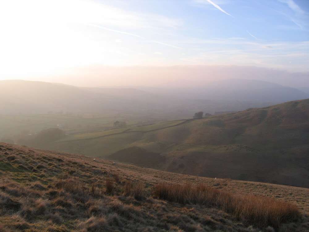 mist rolling over the hills at dusk