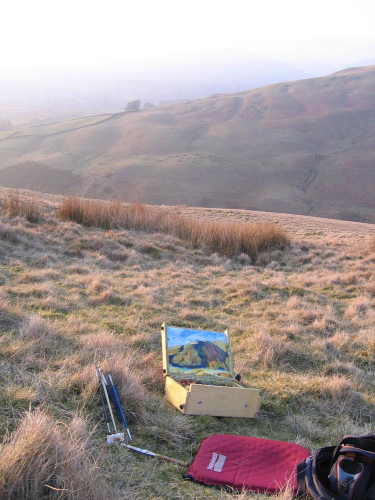plein air painter's pochade box on the hill